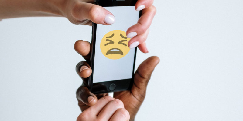 People fighting over phone with sad face